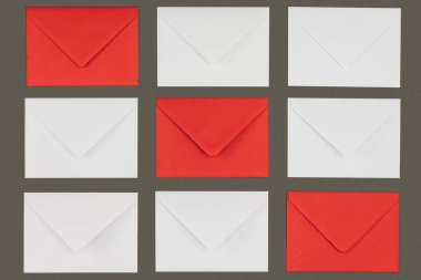 Close-up view of closed red and white envelopes isolated on grey background stock vector