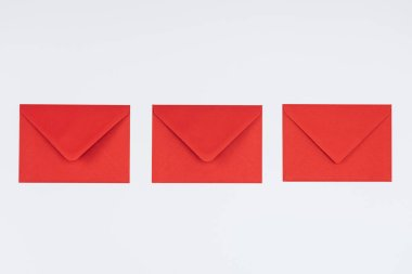 Close-up view of three closed red envelopes isolated on white background stock vector