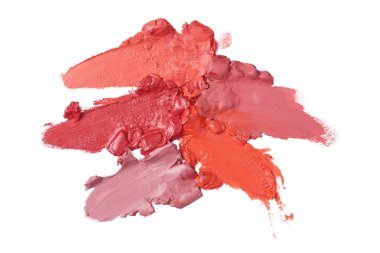 top view of smashed lipsticks on various colors isolated on white