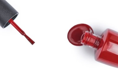 top view of red nail polish on white background