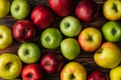 top view of ripe multicolored apples on wooden table