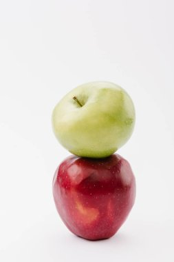 stack of two ripe red and green apples on white background