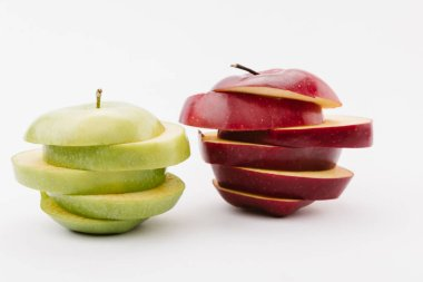 sliced golden and red delicious apples on white background