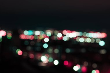 defocused background with bright bokeh lights at night