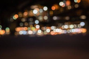 Defocused buildings with bokeh lights at night stock vector