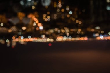 defocused background at night with bokeh lights and copy space