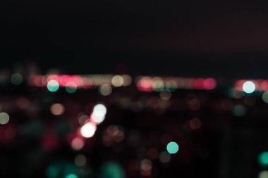 blurred background at night with colorful bokeh lights
