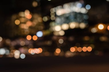 blurred buildings with bokeh lights at night