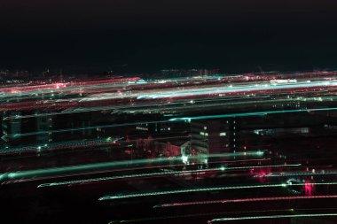 long exposure of night cityscape with defocused bright illumination