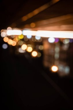 blurred night background with bright bokeh lights