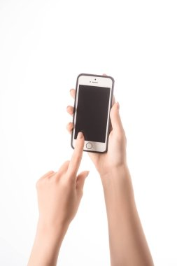 cropped view of woman using smartphone with blank screen isolated on white