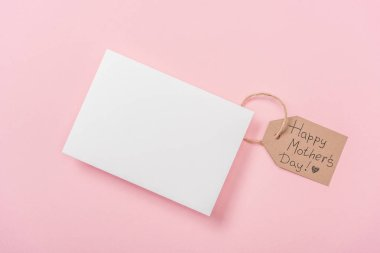 Blank postcard and wooden label with happy mothers day greeting text on pink background stock vector