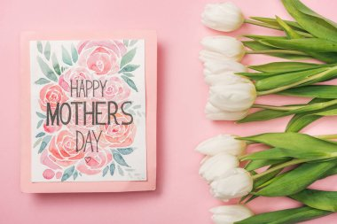 Happy mothers day greeting card and white tulips on pink background stock vector