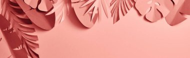 Top view of paper cut palm leaves on pink background, panoramic shot stock vector