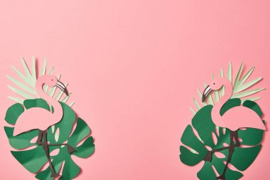 Top view of paper cut flamingos on green palm leaves on pink background with copy space stock vector