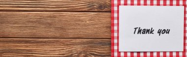 top view of thank you card on wooden brown table with red plaid napkin, panoramic shot
