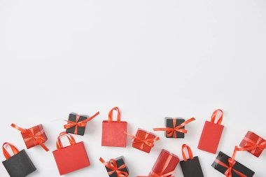Top view of black and red presents and shopping bags on white background with copy space stock vector