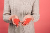 cropped view of woman holding paper artwork with broken heart on pink