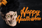 spooky skull on black background with copy space, Halloween decoration with Happy Halloween illustration