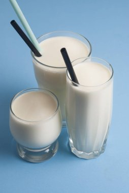 Three glasses Milk Drink Dairy Products Lactose Isolated Blue Board