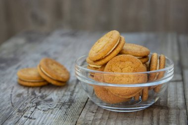 Sandwich, ginger healthy biscuits with cream , close up, isolated. Cookies for tea or snack.