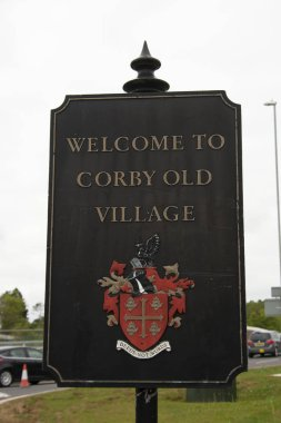 Corby, U.K, April 28, 2019 - Welcome to Corby, U.K sign, Village sign.