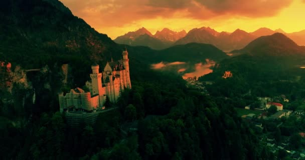 Amazing aerial sunset view of the Neuschwanstein castle, golden sky, twilight on Bavarian Alps, Bavaria, Germany.