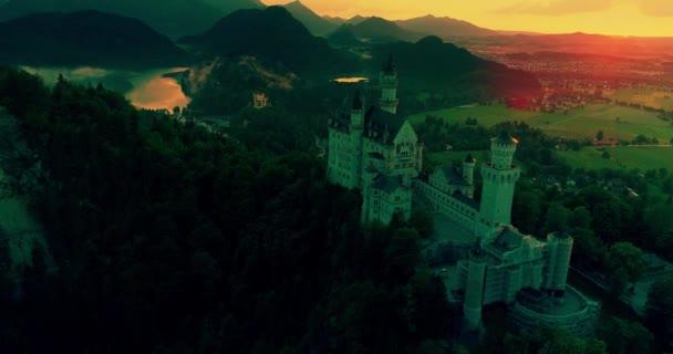 Amazing aerial sunset view of the Neuschwanstein castle, golden sky, twilight on Bavarian Alps, Bavaria, Germany.