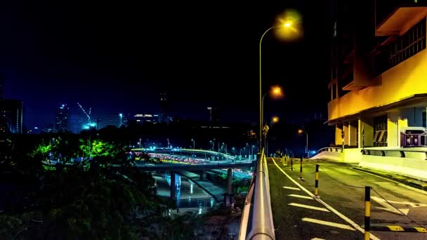 Night city traffic. Avenue and highway. Traffic flowing with blurred motion. 4K Time-Lapse, Night in Kuala Lumpur, Malaysia