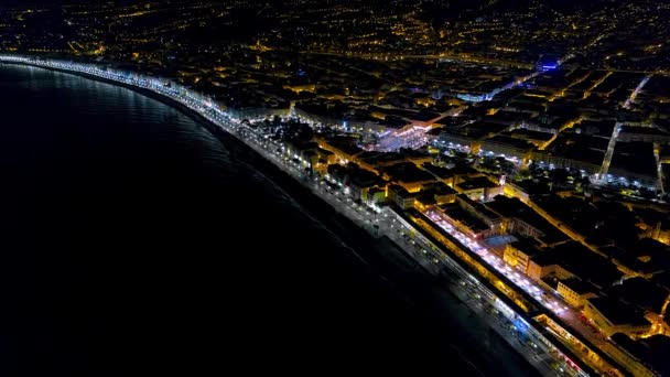 4K Aerial view of Night Nice France promenade, Mediterranean Sea and airport view. France city night panorame. Night city aerial view.