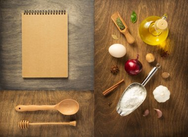 food ingredients and spices at wooden table, top view