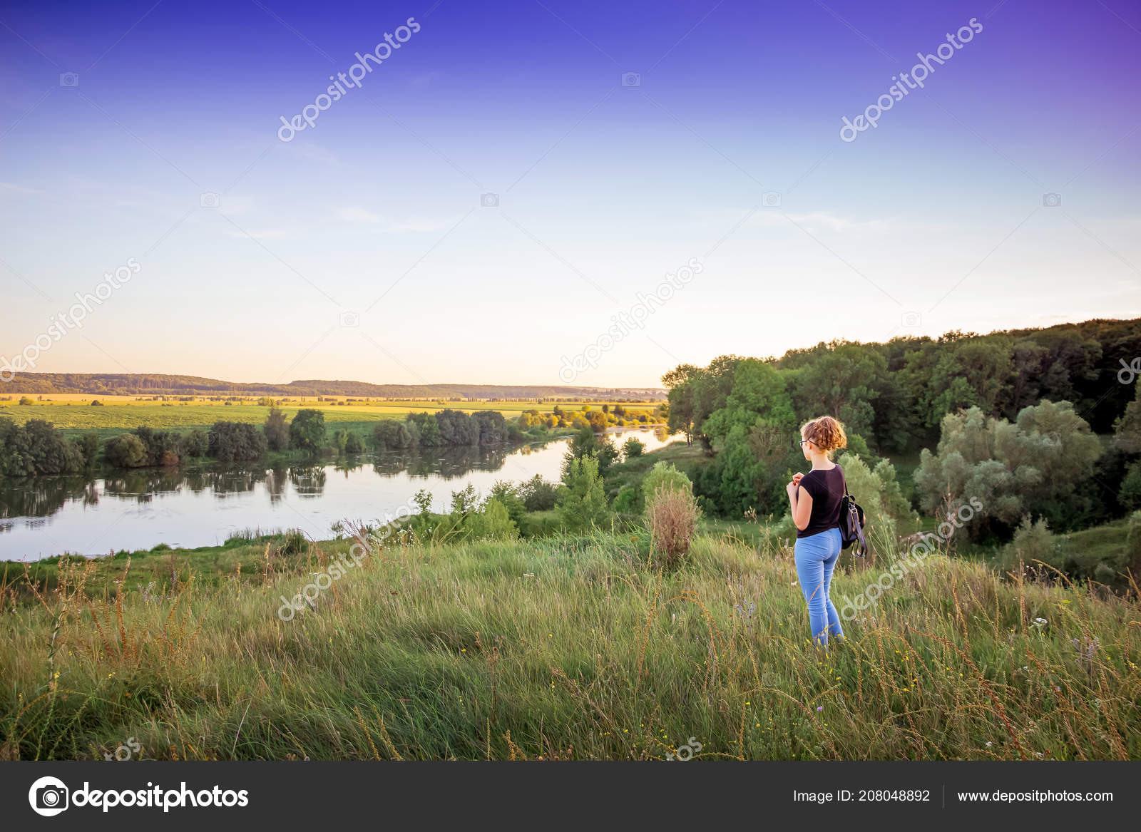 young girl admires beauty nature summer landscape river