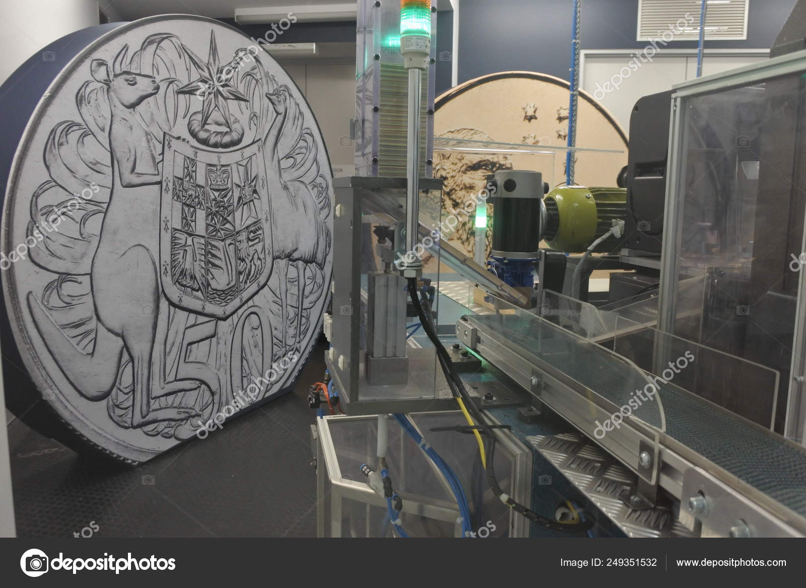 Coin minting machine in the Royal Australian Mint Canberra Austr