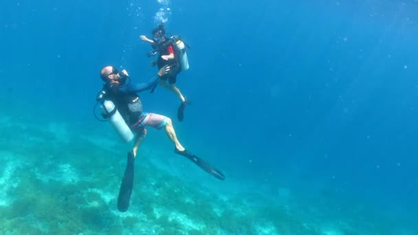Child girl doing a scuba diving course in Gili Islands a world renown diving near Bali and Lombok Islands Indonesia.
