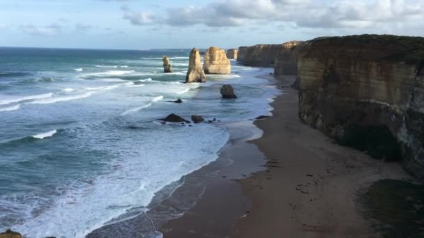 Landscape view of sunrise over the Twelve Apostles at Port Campbell National Park along the Great Ocean Road in Victoria, Australia.