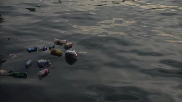 Trash and garbage floating on the surface of the water. Water pollution with dirty and plastic garbage floating on the surface of the sea.