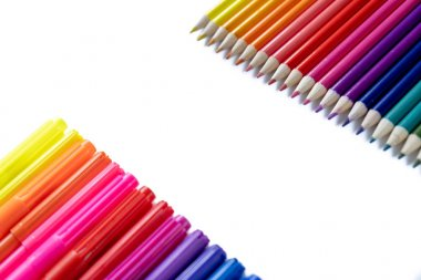 Back to school concept. Closeup images of many color pencils isolated on white background. Flat lay, top view, copy space.