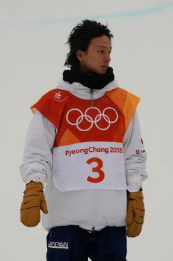 PYEONGCHANG, SOUTH KOREA - FEBRUARY 14, 2018: Silver medalist Ayumu Hirano of Japan during venue ceremony after the men's snowboard halfpipe final at the 2018 Winter Olympics in PyeongChang
