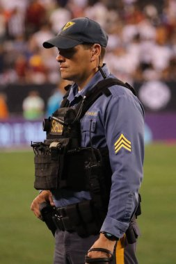 EAST RUTHERFORD, NJ - AUGUST 7, 2018: New Jersey State Police K-9 unit provides security during 2018 International Champions Cup game Real Madrid vs Roma at MetLife stadium