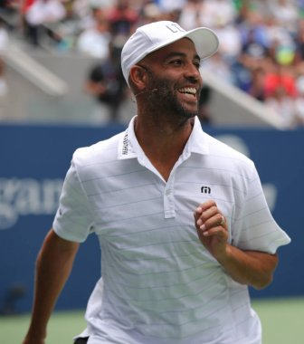 NEW YORK - AUGUST 22, 2018: American retired professional tennis player James Blake in action during 2018 US Open exhibition match at newly open Louis Armstrong Stadium at National Tennis Center