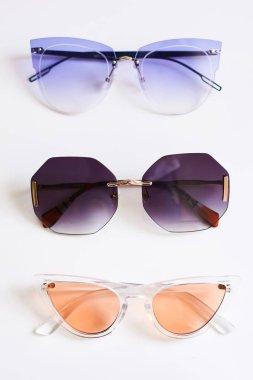 Various colorful stylish fashionable sunglasses isolated on white background