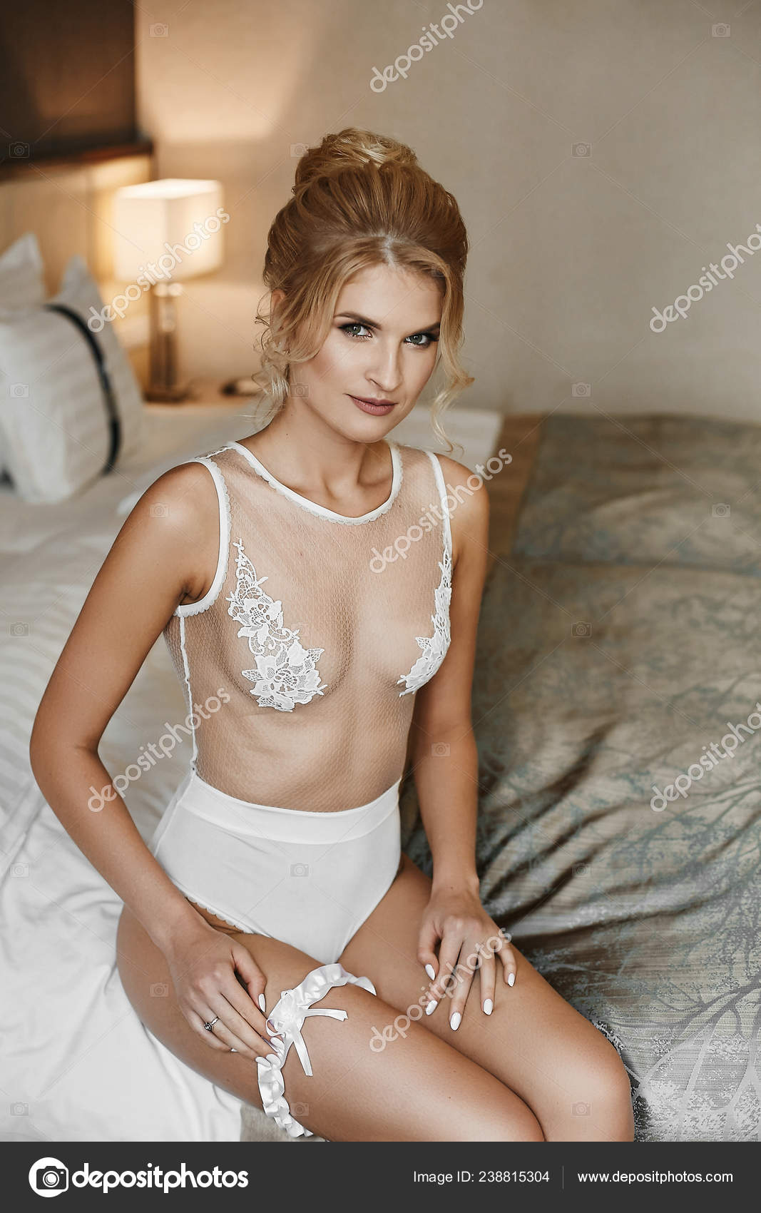 Naked girls indoor Sexy And Beautiful Half Naked Blonde Model Girl With High Hairstyle And With Gentle Makeup In Fashionable Lingerie Puts On Stylish Wedding Garter And Posing At Interior Stock Photo By C Innarevyako 238815304