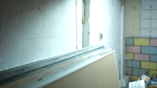 Camera pans down to mold resistant drywall near basement work site