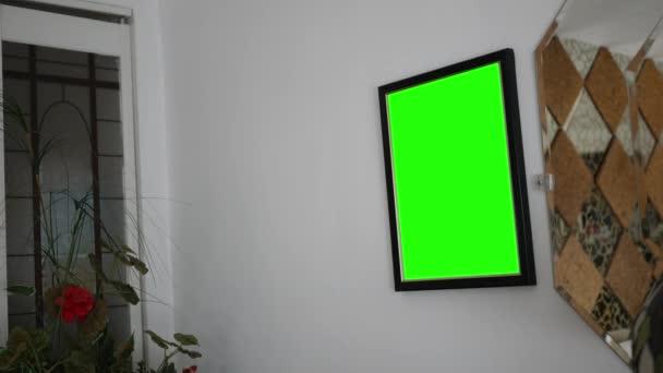 Zelená obrazovka fotorámečku v moderní obývací stěny