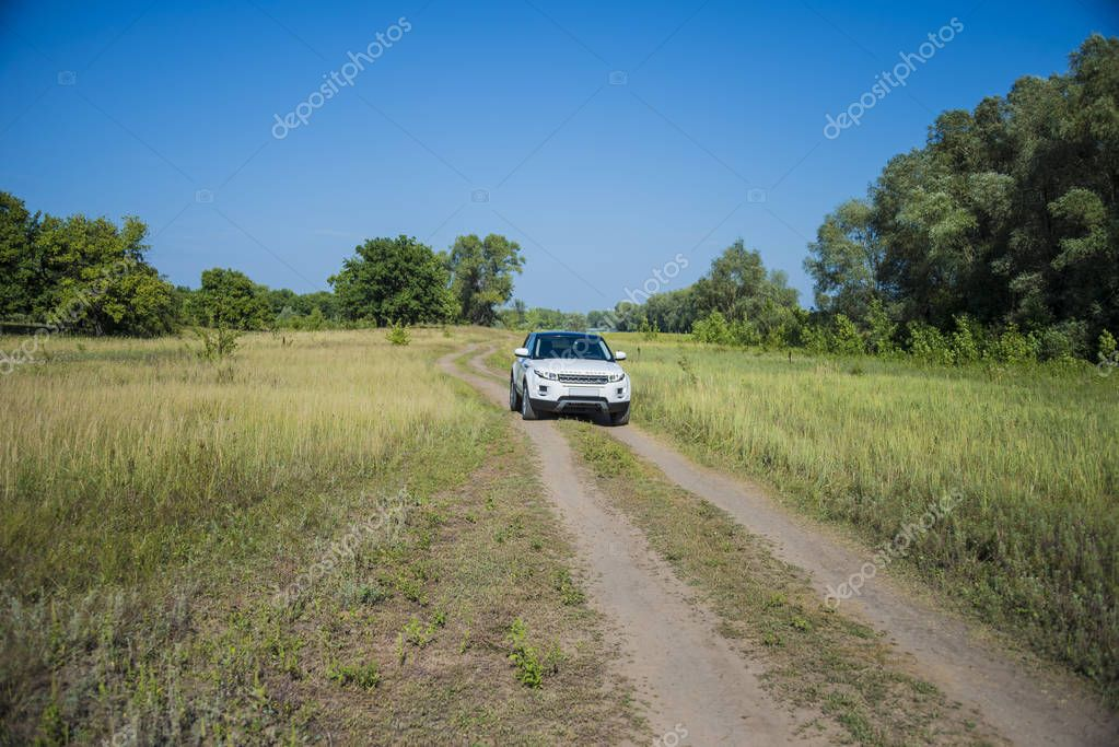 Car Land Rover Range Rover in summer Sunny weather in the summer landscape of the Samara region, Russia. August 21, 2018