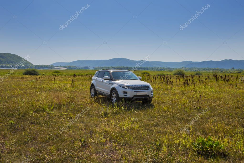 Car Land Rover Range Rover is in the field on a Sunny autumn day near the city of Samara, Russia. August 1, 2018