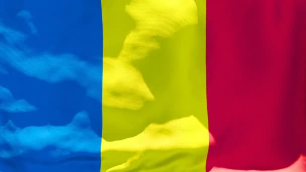The national flag of Romania flutters in the wind
