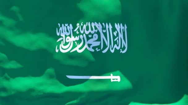 Národní vlajka Saúdské Arábie vlaje ve větru
