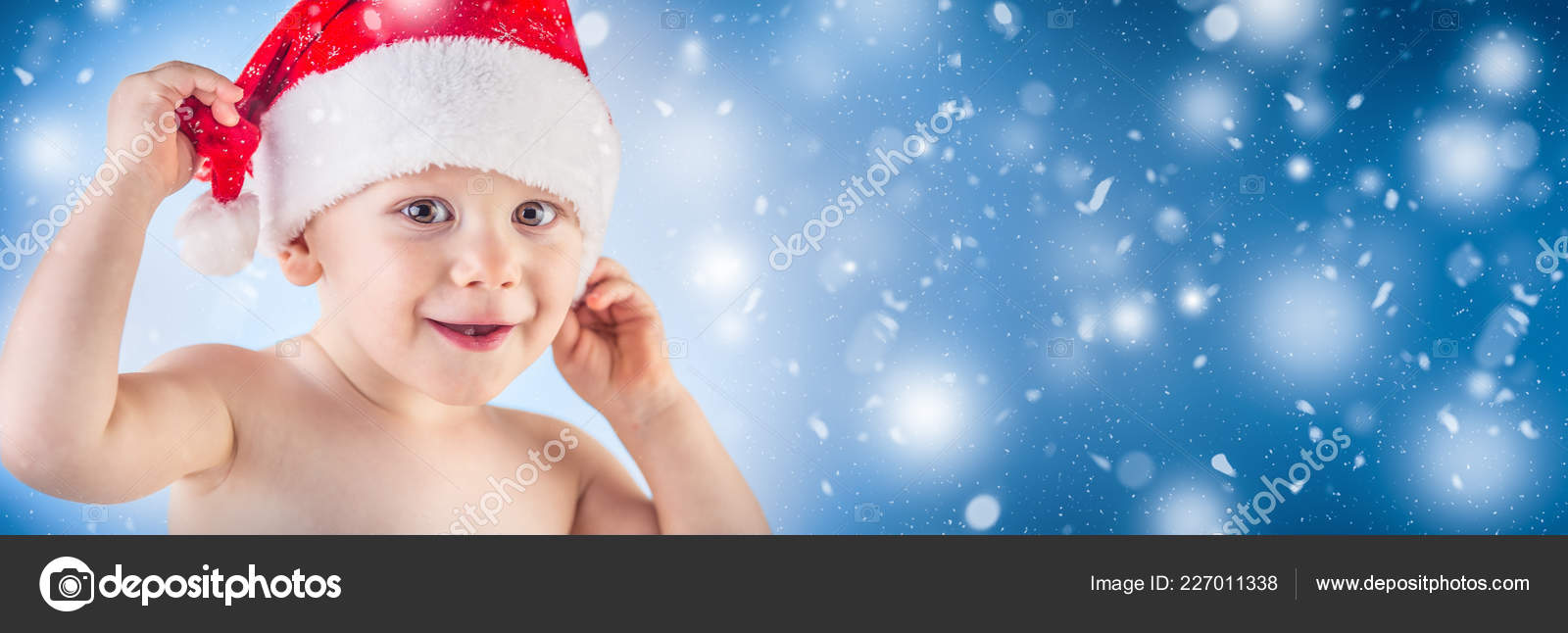 173c39c44e1 Cute Baby Boy Christmas Cap Abstract Snowy Panoramic Banner — Stock Photo