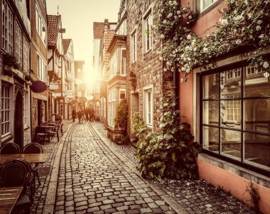 """Картина, постер, плакат, фотообои """"beautiful view of old town in europe in golden evening light at sunset in summer with pastel toned retro vintage instagram style grunge filter and lens flare sunlight effect"""", артикул 393561234"""